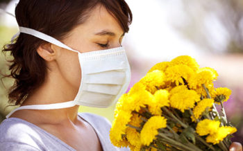 getty_rf_photo_of_allergic_woman_smelling_flowers
